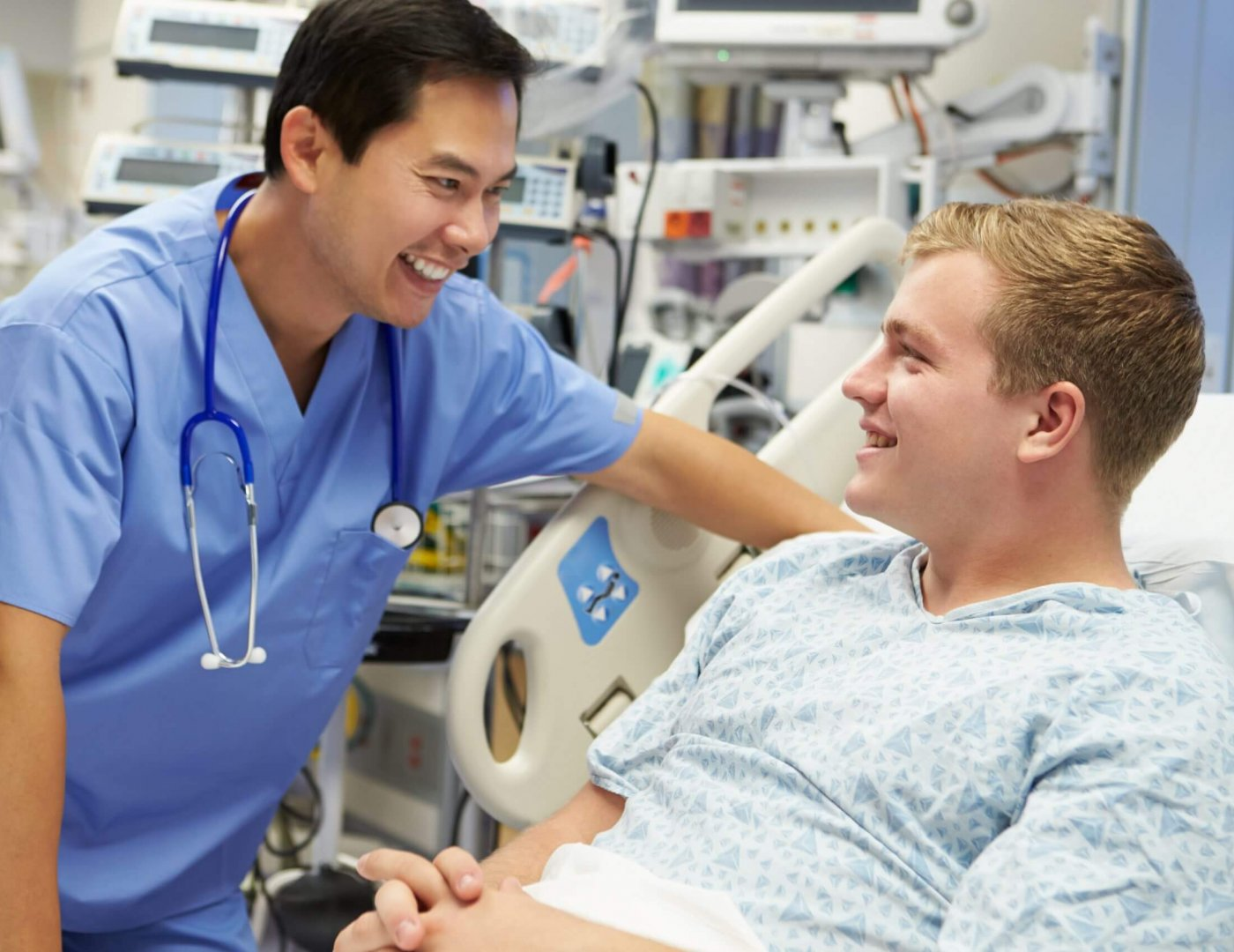 Patient care technician in hospital talking with young patient, patient care technician patient communication
